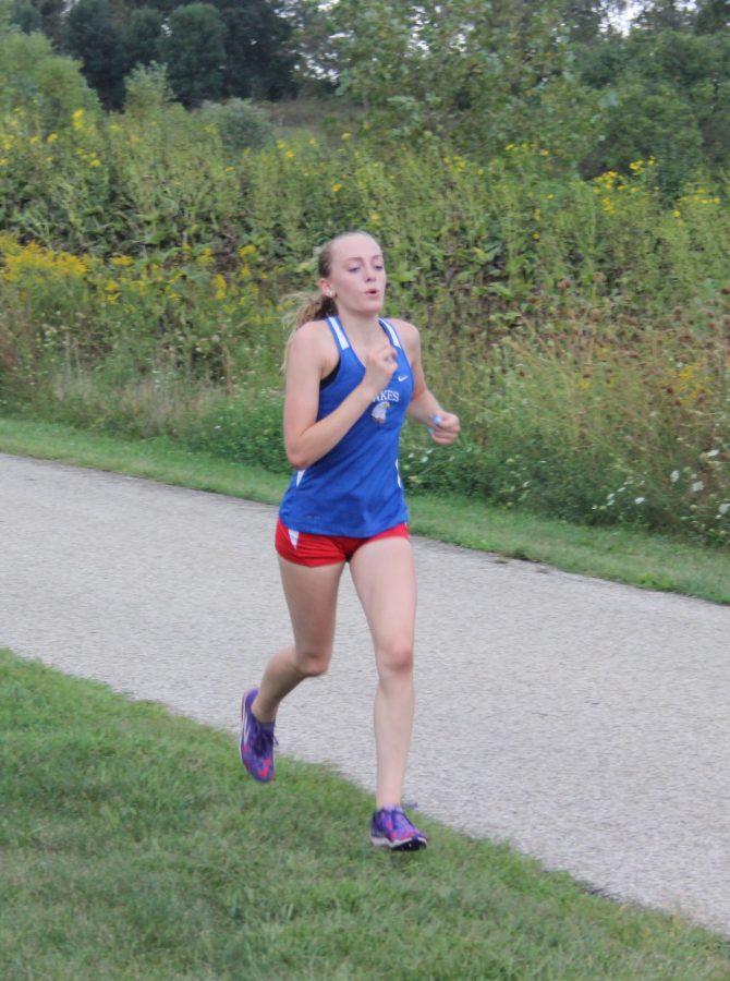Senior captain Alyssa Stromsland running in a meet against Grant on September 8, 2015