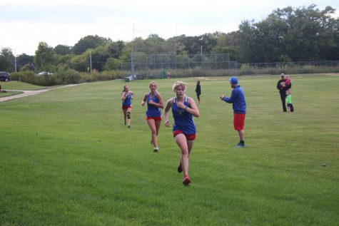 From Left to Right: Senior Natalie Maguire, Sophomore Anna Gardener, and Freshman Tegan Baker running at Lakes against North Chicago and Grayslake North on September 5, 2017.