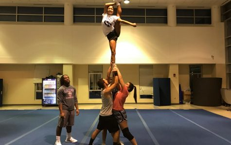 The cheer team practicing their stunts at practice