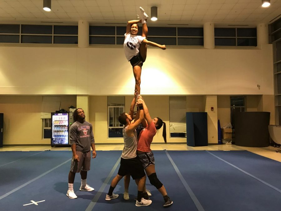 The+cheer+team+practicing+their+stunts+at+practice