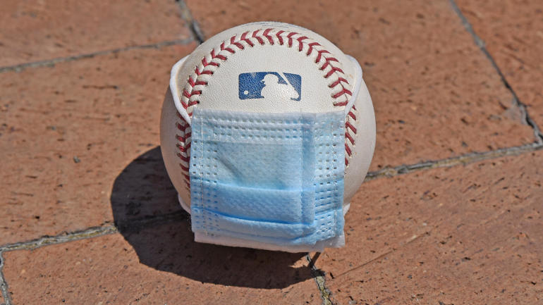 DETROIT, MI - JULY 01:  A detailed view of an official Major League Baseball with a surgical mask placed on it sitting outdie of Comerica Park on July 1, 2020 in Detroit, Michigan.  (Photo by Mark Cunningham/MLB Photos via Getty Images)